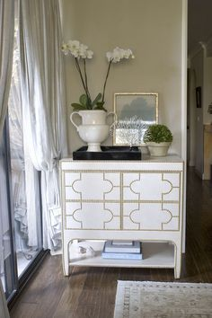 Creative nailhead detail creates the pattern on painted chest.