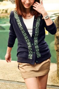 This cardigan crafted in acrylics, polyester and spandex, featuring v-neckline, embroidery to front with sequins embellishment, single breasted, ribbed hemline, in medium length cut.$43