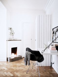 Inside a Chic Small Home With Major Style | DomaineHome.com // Collapsible desk in an office with a fireplace.