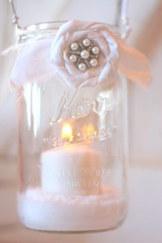 Fill a Mason Jar with a little salt, a candle, and hang it up.