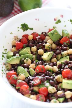 2 cloves garlic, minced 3 tbsp fresh lime juice 1 tbsp extra virgin olive 1 tsp cumin pinch crushed red pepper flakes 1/2 teaspoon salt 15 oz can black beans, rinsed and drained 1 cup canned chickpeas, rinsed and drained 1 cup cherry tomatoes, halved 1/4 cup minced red onion, finely diced 1/4 cup cilantro, chopped 1 medium avocado, diced