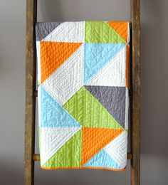 Sewlio: Angle Quilt Tutorial - love the quilting on each color!