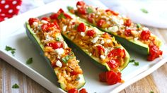 Stuffed zucchini with herbed orzo, almonds, and fresh tomato sauce #MeatlessMonday