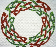 ~free~ pattern:  Celtic Christmas Wreath by Raymond K. Houston.  He designs large-scale Celtic knot quilts that can be made with fusible applique rather than bias tape.  This is an original design.