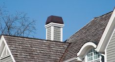 Dynasty style chimney crown in oil rubbed bronze atop a Wolf Korndorfer custom home in Racine WI, from Chimney King.