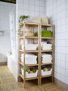 The MOLGER shelving unit creates easy access to bath linens and basic bath accessories.