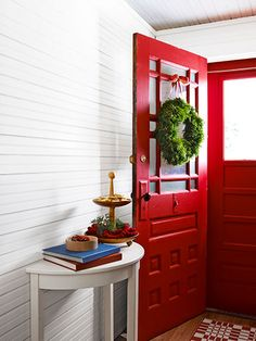 Hang a pine wreath on a red door for an appealing contrast.