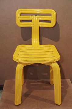 The Chubby Chair: a 3D-printed chair made from recycled refrigerator plastic. The plastic is ground into a paste, then used to build up each of the chair's components layer by layer. Even the offcuts from the process are reused: they're turned into matching chubby coat hangers. chair, coat hanger