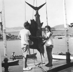 Newlyweds John and Jacqueline Kennedy admiring the Sailfish landed by Senator Kennedy during their honeymoon in Acapulco, Mexico, September 1953.