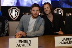 Jensen Ackles (left) and Jared Padalecki, stars of the long-running series SUPERNATURAL, sign for fans at the Warner Bros. booth at Comic-Con 2012 (© WBEI. All Rights Reserved.)