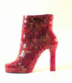 red mosaic shoe sculpture