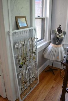 recycled springs from baby bed to hang your necklaces!