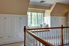 An awkward upper landing that often appears when an attic with dormers is converted into bedrooms can turn into storage and a window seat.