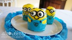 An idea. minion cupcakes. Rachel we could make a whole army of minion cupcakes. How cute would that be. Here is a tutorial. It looks like it wouldn't bee to hard.