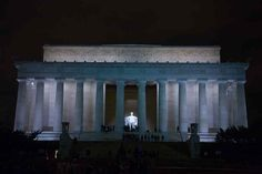 Lincoln Memorial, Washington DC. Dedicated to the 16th President, the building is in the form of a Doric temple containing the white marble statue of Lincoln facing down the Reflecting Pool to the Washington Monument.