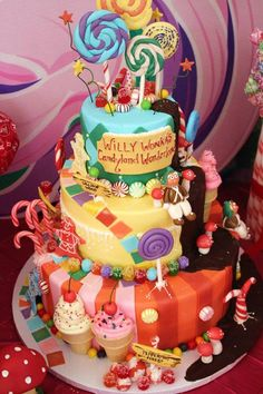 An amazing cake at A Willy Wonka's Candyland Wonderland Themed Party with So Many Cute Ideas via Kara's Party Ideas KarasPartyIdeas.com #WillyWonkaParty #CharlieAndTheChocolateFactory #CandyLand #Wonderland #cake