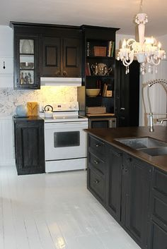 seriously thinking about painting my cabinets black!
