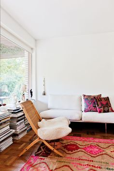 #living #space #room #home #color #print #rug #white #chair #magazine #stack #style #interior
