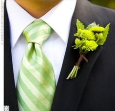 Green Kermit mums mixed with fresh leaves and berries wedding flower boutonniere, groom boutonniere, groom flowers, add pic source on comment and we will update it. www.myfloweraffair.com can create this beautiful wedding flower look.