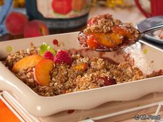 Peach Melba Crumble - This warm peach crisp goes great with a heaping scoop of ice cream in the summer. It only takes about 30 minutes to cook, so you can enjoy this simple dessert recipe anytime you want it!