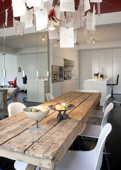 "Dining Tables in Rustic Style paired with a ""swish"" chair // letters art installation above table // mirrors"