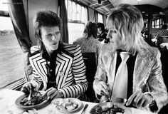 Bowie & Mick Ronson in amazing suits, eating breakfast.