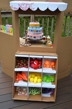 Cardboard play grocery stand - could easily combine math and language with this play station.