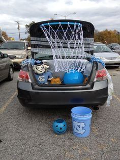 Trunk or treat--basketball goal made with a hula hoop and thick yarn.