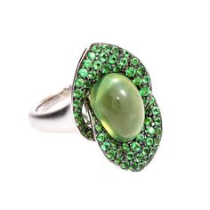 """Rodney Rayner 18k White Gold """"Lily ring"""" with a centre 10.23ct. Cabochon Prehnite and 2.11cts. of Tsavorites"""