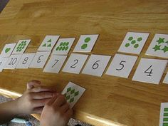 Here's a nice set of materials for counting and number recognition. Cards can also be used to play a memory game.
