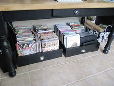 Repurposed kitchen drawers hold magazines, notebooks, etc.  Add casters for easier pulling out.