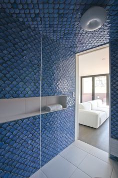 6,000 handcrafted blue scalloped tiles for the fourth-floor bathroom of architect Alex Gil.