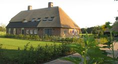 Surrounded by peaceful countryside, B&B Gasterij de Heihorst offers rooms with a private terrace. The thatched-roof #farmhouse has a library and a spacious garden. #visitholland #bedandbreakfast
