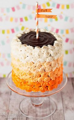 Bakingdom - Piped Buttercream tip 21 reverse shell.  Orange Ombre cake