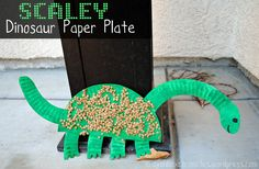 Dinosaur paper plate craft w/ lentils for sensory play