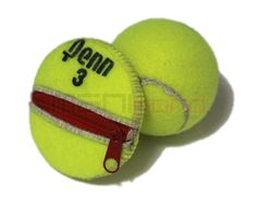 Recycled Tennis Ball Round/Compact Change Holder with Zipper. $18.50, via Etsy.