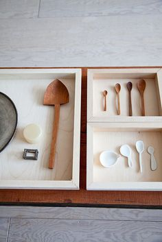 Some wood spoons by Ryuji Mitani, and ceramic spoons by Nathalie Lahdenmaki.