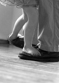 Dancing on daddy's shoes.