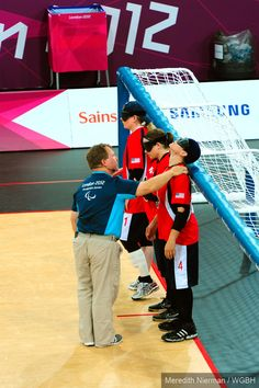 The USA goalball team has their masks checked by a ref at the 2012 Paralympic Games in London