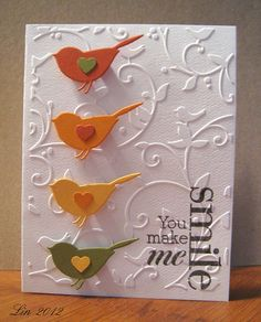 Love the sweet column of birds and the embossed background.