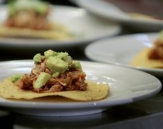 Tiny Tostadas of Smoky Chicken Tinga with Avocado and Aged Cheese