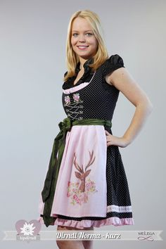 Love the stag's head apron! #dirndl #German #Austrian #traditional #folk #costume #dress #tracht #deer
