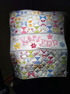 Hourglass block baby quilt with applique
