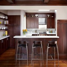 One-Space Makeover  Great version of opening kitchen to dining room. Love the counter as room divider/connector.