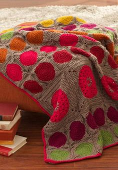 Large and small pop color circle motifs add a modern feel to this afghan. Shown in Patons Canadiana..
