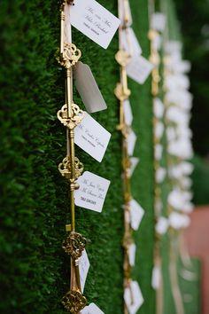 gold key escort cards, photo by Richard Israel http://ruffledblog.com/charlotte-botanical-gardens-wedding #weddingideas #seatingchart