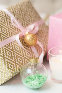 Learn how to make a gorgeous Confetti-Filled Christmas ornament with our step-by-step tutorial. #Christmas #DIY