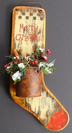 Primitive Christmas Stocking Rusty Can Hand Painted Wood. $15.95, via Etsy.