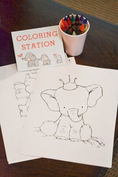 Elephant themed first birthday - coloring station great idea for the small kids to have something to keep them occupied