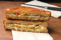 grilled cheese with tomato, pickles, and potato chips.  irrationally drawn to this.